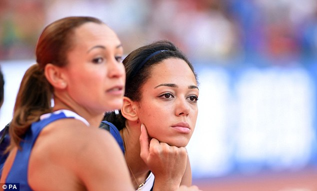 Katarina Johnson-Thompson (right) and Ennis-Hill look on following the conclusion of the long jump