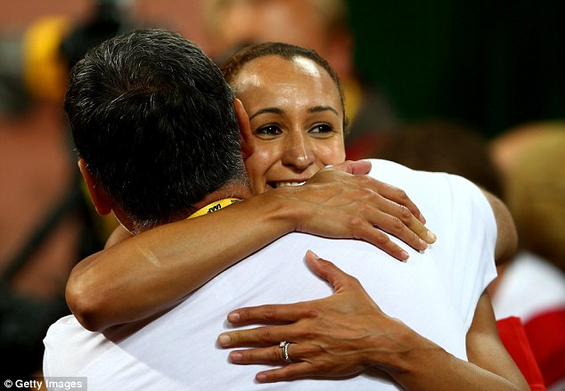 The 29-year-old shares the celebrations with her coach Toni Minichiello following her gold in Beijing