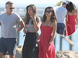 EXCLUSIVE PICTURES \n\nJun 4 2016\n\nGary Lineker and ex-wife Danielle Bux show affection and look very close again as they have a day out with Danielle's daughter Ella, in Malibu Beach, CA\nThe former couple looked anything but divorced as they enjoyed the relaxing day, at one point Gary was seen to rest his head on the shoulder of his ex-wife as they left Malibu Pier.\n\nGary is heading back to London soon when he'll travel on to France to work as a pundit at Euro 2016\n\nCredit Line Must Read: Lemon Light-Media\n\nPlease Agree Terms Before Use