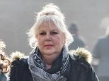 Ben Cohen's mother-in-law Felicity Blayney-Bassouls is pictured arriving at Northampton Magistrates court today March 18, 2015.  ....Ben Cohen's mother-in-law is appearing in court after allegedly harassing the former rugby player following his split from her daughter.  ....Felicity Bassouls, 67, was outspoken in her criticism of Cohen - labelling him a 'disrespectful bully' - after he broke up with Abby late last year amid rumours of an affair with his Strictly Come Dancing partner Kristina Rihanoff.  The athlete and activist, who was part of England's 2003 Rugby World Cup winning squad, had been married to Abby for 11 years and the couple have twin daughters.  Mrs Bassouls is accused of bombarding Cohen with calls and emails. ....See NTI story NTISTRICTLY.