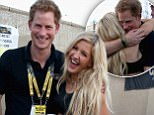 LONDON, ENGLAND - SEPTEMBER 14:  Prince Harry with Ellie Goulding backstage at the Invictus Games Closing Ceremony during the Invictus Games at Queen Elizabeth park on September 14, 2014 in London, England. The International sports event for 'wounded warriors', presented by Jaguar Land Rover was an idea developed by Prince Harry after he visited the Warrior Games in Colorado USA. The four day event has brought together thirteen teams from around the world to compete in nine events such as wheelchair basketball and sitting volleyball.  (Photo by Chris Jackson/Getty Images)