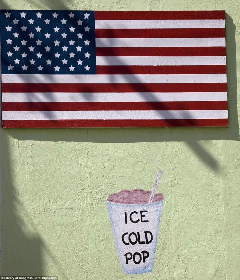 Patriotic pop: Advertising and an American flag on Route 66, Seligman, Arizona