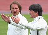 EVIAN-LES-BAINS, FRANCE - JUNE 08:  Joachim Loew, head coach of the German national team talks to his assistant coach Thomas Schneider (L) during a Germany training session ahead of the UEFA EURO 2016 at Ermitage Evian on June 8, 2016 in Evian-les-Bains, France. Germany's opening match at the European Championship is against Ukraine on June 12.  (Photo by Alexander Hassenstein/Getty Images,)