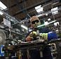 A workman brazes a component of a Brompton folding bicycle in their factory in Brentford on November 13, 2012 in London, England.   Brompton is one of only two major bike frame manufacturers still based in the UK, creating all their folding bicycles in West London. The original Brompton patent was filed in 1979 by the inventor Andrew Ritchie and basic design remains largely unchanged. Each bike is comprised of over 1200 parts and takes approximately 6 hours to construct..  (Photo by Oli Scarff/Getty Images) LONDON, ENGLAND - NOVEMBER 13 2012