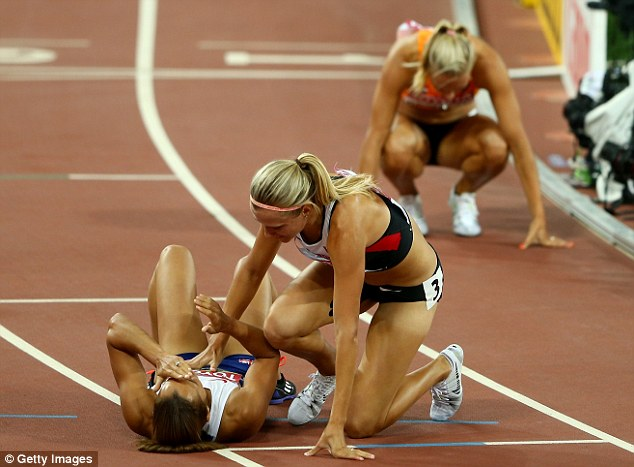 Ennis-Hill realises the extent of her achievement and collapses to the ground as the emotions take over