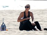 Maria Sharapova, pictured playing tennis on the beach in LA on Tuesday, has been banned for two years