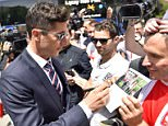 Bayern Munich striker Robert Lewandowski led the players off the team bus and to the fans that greeted them