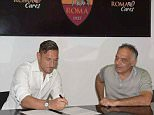 Totti signs picture.JPG