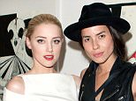 """NEW YORK, NY - JUNE 22:  Actress Amber Heard and artist Tasya Van Ree attends Tasya Van Ree's private viewing of """"Distorted Delicacies"""" at Vs. Magazine & Creative Studios Paris' Space on June 22, 2011 in New York City.  (Photo by Dario Cantatore/Getty Images)"""