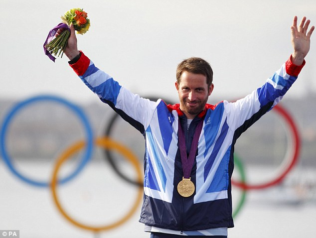 Conqueror: Ben Ainslie celebrates his fourth gold medal, making him the most successful sailor in modern Olympic history