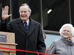 FILE - In this Dec. 7, 2009 file photo, former President George H.W. Bush and former first lady Barbara Bush arrive for a ceremony to dedicate an expanded gallery that carries his name at the National Museum of the Pacific War, in Fredericksburg, Texas. Barbara Bush is celebrating her 91st birthday with her family in Maine. She and former President George H.W. Bush are being joined by family members including their son, former President George W. Bush, to help her celebrate on Wednesday, June 8, 2016.  (AP Photo/Eric Gay, File)