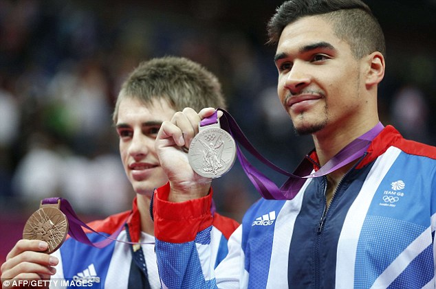 Success: Gymnasts Max Whitlock (left) and Louis Smith (right) show off their medals on another excellent day for Team GB