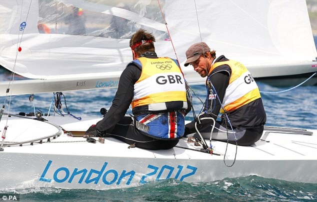 Downbeat: Great Britain's Iain Percy (right) and Andrew Simpson (left) looked dejected after losing their Olympic crown, but they still came away with silver medals