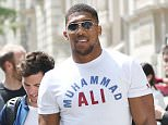 05 June 2016 - London - UK *EXCLUSIVE ALL ROUND PICTURES* British heavyweight champion boxer. Anthony Joshua sporting a Muhammad Ali T Shirt while greeting fans at the Corinthia Hotel in London Byline Must Read: XPOSUREPHOTOS.COM ** UK clients please pixelate children's faces prior to publication** For content licensing please contact: Xposure Photos pictures@xposurephotos.com  44 (0) 208 344 2007