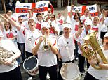 A group of England fans accompanied by the England Supporters band during their world record for the longest continuous chant ahead of the Euro 2004 tournament, in Covent Garden Piazza, Central London, England on Wednesday 9 June 2004.  The supporters and the band kept up The Great Escape theme for 90 minutes without a break. PA Photo: Andy Butterton.