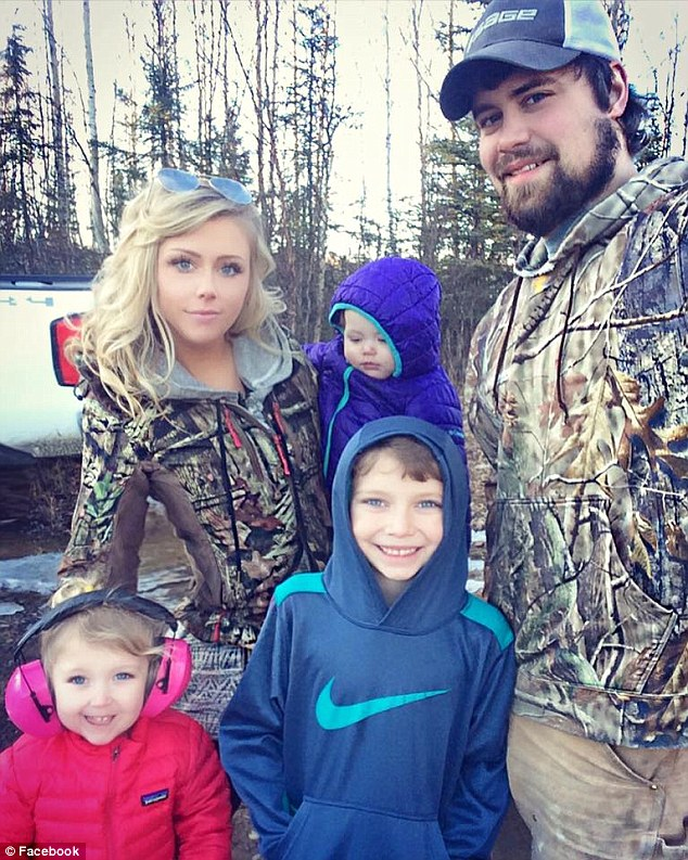 Family: Levi (right), who also has two younger children with his wife Sunny Oglesby (left), is pictured with his wife and three children, including Tripp (center)