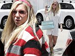 153318, EXCLUSIVE: In good spirits, Kesha changes up her look as she arrives for multiple meetings at the Four Seasons. For her first meeting she arrived in a loose white button up dress; the second she took a more wintery angle and wore a bold striped oversized jacket. Los Angeles, California - Tuesday June 7, 2016. Photograph: © PacificCoastNews. Los Angeles Office: +1 310.822.0419 UK Office: +44 (0) 20 7421 6000 sales@pacificcoastnews.com FEE MUST BE AGREED PRIOR TO USAGE