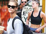 """Picture Shows: Nina Agdal  June 08, 2016\n \n Model Nina Agdal stops for an iced coffee while out and about in New York City, New York. Nina, who was at one time briefly linked to Leonardo DiCaprio, could be seen rocking a shirt that reads, """"EAT PRAY BARRYS.""""\n \n UK RIGHTS ONLY\n \n Pictures by : FameFlynet UK © 2016\n Tel : +44 (0)20 3551 5049\n Email : info@fameflynet.uk.com"""