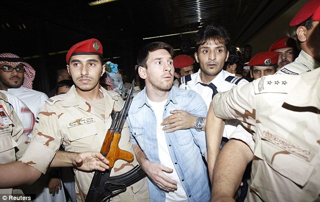Mobbed: Messi (centre) and Aguero are in Saudi Arabia on international duty with Argentina