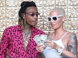*PREMIUM-EXCLUSIVE* Los Angeles, CA - *PREMIUM EXCLUSIVE* **MUST CALL FOR PRICING** **USA AND CANADA STRICTLY NO TV, NO WEB* Los Angeles, CA - Amber Rose and Wiz Khalifa celebrated their divorce Monday night at a strip club, and now we know why ... each did more than okay in the settlement.\n\nAmber and Wiz filed their settlement agreement with the court, and the headline ... she gets a cool million under the prenup. Wiz has already paid $356k, so he still owes her $644k.\n\nBut Amber gets more ... $14,800 a month in child support for their 3-year-old son, Sebastian, with whom they share legal and physical custody.\n\nAs for Wiz ... he gets the Pennsylvania home and 10 cars, including a '69 Chevelle, a '68 Camaro, a '62 and a '64 Impala and a Porsche, of course, of course.\n\nBiggest thing ... they're both good with the way the divorce ended, which is ultimately good for the kid.\n\n **MANDATORY CREDIT: TMZ/AKM-GSI** **USA AND CANADA STRICTLY NO TV, NO WEB**\n\nAKM-GSI       June 7, 2