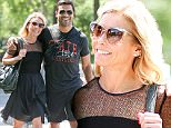*EXCLUSIVE* New York, NY - Kelly Ripa and Mark Consuelos take a romantic stroll in Central Park. The happily married couple are seen smiling and giggling as they walk with their arms around each other in sunny NYC.\n  \nAKM-GSI       June 7, 2016\nTo License These Photos, Please Contact :\nMaria Buda\n(917) 242-1505\nmbuda@akmgsi.com\nsales@akmgsi.com\nMark Satter\n(317) 691-9592\nmsatter@akmgsi.com\nsales@akmgsi.com\nwww.akmgsi.com