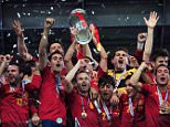 Spain celebrate their victory with the trophy during the UEFA EURO 2012 final match between Spain and Italy at the Olympic Stadium on July 1, 2012 in Kiev, Ukraine.    (Photo by Shaun Botterill/Getty Images)