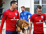 Smalling and Jamie Vardy speak as they head for a training session in Chantilly on Thursday