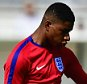 CHANTILLY, FRANCE - JUNE 07:  Marcus Rashford shoots during an England training session ahead of the UEFA EURO 2016 at Stade du Bourgognes on June 7, 2016 in Chantilly, France. England's opening match at the European Championship is against Russia on June 11.  (Photo by Dan Mullan/Getty Images)