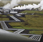 FILE - In this July 28, 2011 file photo, giant ducts carry superheated steam from within a volcanic field to the turbines at Reykjavik Energy's Hellisheidi geothermal power plant in Iceland. Scientists have a found a quick but not cheap way to turn heat-trapping carbon dioxide into harmless rock. Experts say the results of a two-year $10 million experiment called CarbFix about one-third of a mile (540 meters) deep in the rocks of Iceland offers new hope for an effective weapon in part of the fight against man-made global warming.  (AP Photo/Brennan Linsley, Fie)
