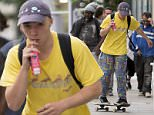 MUST BYLINE: EROTEME.CO.UK\nRocco Ritchie showcases his unique style as he is spotted skateboarding in colourful harem pants while drinking a juice in Primrose Hill.\nEXCLUSIVE  June 9, 2016\nJob: 160608L10  London, England \nEROTEME.CO.UK\n44 207 431 1598\nRef: 341629\n