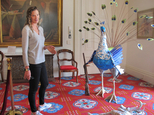 Artist Katie Hunt, the wife of Vermont Gov. Peter Shumlin, stands by an art display she created in the governor's ceremonial office in Montpelier, Vt., Wednesday June 8, 2016. Hunt, who has been married to the Democratic governor since December, says the art is meant to be a satirical look at their lives. Hunt did the sculptures as part of her senior thesis at Mount Holyoke College. Shumlin says he's proud of his wife's work.  (AP Photo/Wilson Ring)