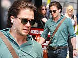 9 June 2016.\nGames Of Thrones actor Kit Harington arriving at the Duke of York Theatre  for the afternoon performance of his play 'Doctor Faustus' in the West End.  Kit was carring a few bags from 'Pret A Manger' and a special bag with whiskey bottles from the 'Royal Mile Whiskies' store in Edinburgh.  Kit beard is making a comeback after he shaved it off last week - London \nCredit: GoffPhotos.com   Ref: KGC-130\n