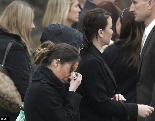 Shock: There were emotional scenes as mourners lined the streets outside St Patrick's Church as Sean Collier's coffin was removed