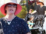 EXCLUSIVE: Drew Barrymore takes her daughters on an exciting day out at Disneyland. Drew, joined with her two daughters Frankie and Olive, a bodyguard and a nanny were seen strolling through the park and