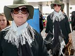 Los Angeles, CA - Melissa McCarthy departs LAX wearing an olive green hat and a scarf. The 45-year-old actress layers up for her travels sporting a white tassel scarf. \n \n AKM-GSI June 9, 2016\nTo License These Photos, Please Contact :\nMaria Buda\n(917) 242-1505\nmbuda@akmgsi.com\nsales@akmgsi.com\nor \nMark Satter\n (317) 691-9592\n msatter@akmgsi.com\n sales@akmgsi.com\n www.akmgsi.com