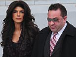 NEWARK, NJ - MARCH 04:  Teresa Giudice and Joe Giudice are seen outside a federal criminal court, where they face mortgage and bankruptcy fraud charges on  March 4, 2014 in Newark, New Jersey.  (Photo by Alo Ceballos/GC Images