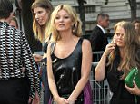 Model Kate Moss at Miu Miu fragrance launch, Haute Couture, Paris Fashion Week, France.   WEARING PRADA SAME OUTFIT AS CATWALK MODEL 4895743e
