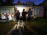 People visit the boyhood home of Muhammad Ali in Louisville, Ky., on Thursday, June 9, 2016, the night before Ali's funeral and memorial services. (AP Photo/Mark Humphrey)