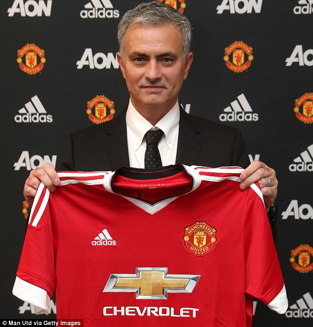 Jose Mourinho poses with a Manchester United shirt and will look to revitalise the club