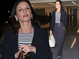 08 June 2016  - Los Angeles, CA  - USA\n**STRICTLY AVAILABLE FOR UK AND GERMANY USE ONLY**\nCatherine Zeta-Jones arrives at LAX Airport for a departing flight to New York City. The Welsh actress wore a navy blue peacoat over a striped top and matching blue high waisted trousers.\nBYLINE MUST READ : AKM-GSI-XPOSURE\n***UK CLIENTS - PICTURES CONTAINING CHILDREN PLEASE PIXELATE FACE PRIOR TO PUBLICATION ***\n*UK CLIENTS MUST CALL PRIOR TO TV OR ONLINE USAGE PLEASE TELEPHONE 0208 344 2007*\n