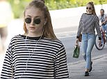 9 Jun 2016  - London  - UK\n*** EXCLUSIVE ALL ROUND PICTURES ***\nGame of Thrones star Sophie Turner dressed in casual attire with ripped jeans, a striped top and sunglasses goes for a stroll in the sun in North London. \nBYLINE MUST READ : XPOSUREPHOTOS.COM\n***UK CLIENTS - PICTURES CONTAINING CHILDREN PLEASE PIXELATE FACE PRIOR TO PUBLICATION ***\n**UK CLIENTS MUST CALL PRIOR TO TV OR ONLINE USAGE PLEASE TELEPHONE  442083442007