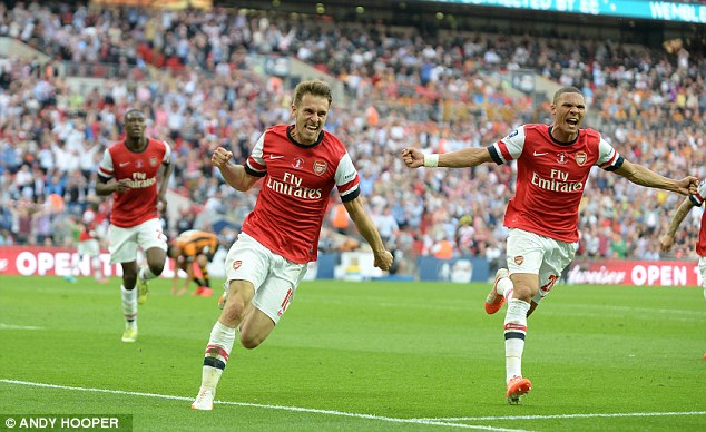 Comeback: Aaron Ramsey celebrates after scoring the crucial goal in extra time