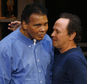 "FILE - In this Jan. 17, 2007, file photo, Billy Crystal, right, hugs boxing legend Muhammad Ali and honors him on his 65th birthday during intermission of Crystal's show ""700 Sundays"" in Tempe, Ariz. Long before movie stardom, Crystal was still a relative unknown in the early 1970s when he was picked as part of a dais that would help roast Ali at a banquet. Crystal's Ali routine¿he also mimicked longtime Ali foil Howard Cosell¿would become a part of his act for the rest of his career.  (AP Photo/Ross D. Franklin, File)"