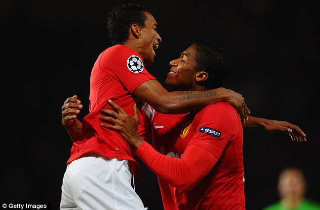 Brothers in arms: Valencia (right) is congratulated by Luis Nani