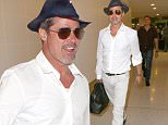 153408, Brad Pitt Makes his way through Los Angeles International Airport wearing all white, with a hat and sunglasses. Los Angeles, California - Thursday June 9, 2016. Photograph: © MHD, PacificCoastNews. Los Angeles Office: +1 310.822.0419 UK Office: +44 (0) 20 7421 6000 sales@pacificcoastnews.com FEE MUST BE AGREED PRIOR TO USAGE