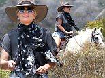 *EXCLUSIVE* Malibu, CA - Lady Gaga saddles up for a horseback riding workout in the hills of Malibu with her bodyguards. Gaga appeared to be smoking a funny cigarette when she got further away from the cameras, and wasn't seen smoking anything else when she returned down the hill with her horse.\nAKM-GSI     June 8, 2016\n \n To License These Photos, Please Contact :\n \n Maria Buda\n (917) 242-1505\n mbuda@akmgsi.com\n sales@akmgsi.com\n \n or \n \n Mark Satter\n (317) 691-9592\n msatter@akmgsi.com\n sales@akmgsi.com\n www.akmgsi.com\n