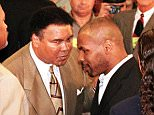 Former heavyweight boxing champion Mike Tyson (R) shakes hands with former heavyweight boxing champion Muhammad Ali (L) following the Nevada State Athletic Commission's decision to reinstate at their hearing in Las Vegas, Nevada 19 October. Ali's wife Lonnie read a prepared statement from Ali supporting Tyson's return to boxing.  AFP PHOTO/Mike NELSON...SPO...BOXING