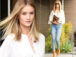 West Hollywood, CA - Rosie Huntington-Whiteley arrives to her office looking chic in jeans and a white blouse paired with camel lace up heels. The towering runway model adds size to her already tall figure with an additional 6 inch heels.\nAKM-GSI       June 9, 2016\nTo License These Photos, Please Contact :\nMaria Buda\n(917) 242-1505\nmbuda@akmgsi.com\nsales@akmgsi.com\nor\nMark Satter\n(317) 691-9592\nmsatter@akmgsi.com\nsales@akmgsi.com\nwww.akmgsi.com