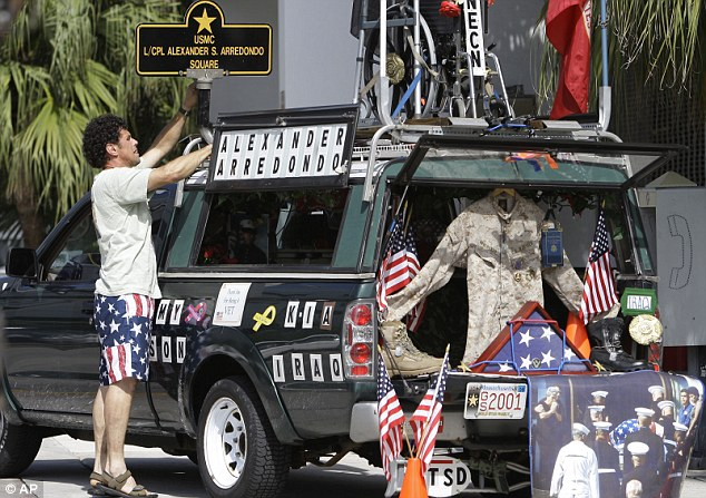 Protest: Carlos Arredondo on Memorial Day, 2009, with his truck decked out in memory of his son, who was killed at the age of 20 while serving as a Marine during the Iraq War