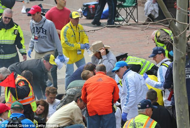 Mr Arredondo (centre) was seen pulling debris and fencing away from the bloody victims, clearing the way for emergency personnel to tend to their wounds